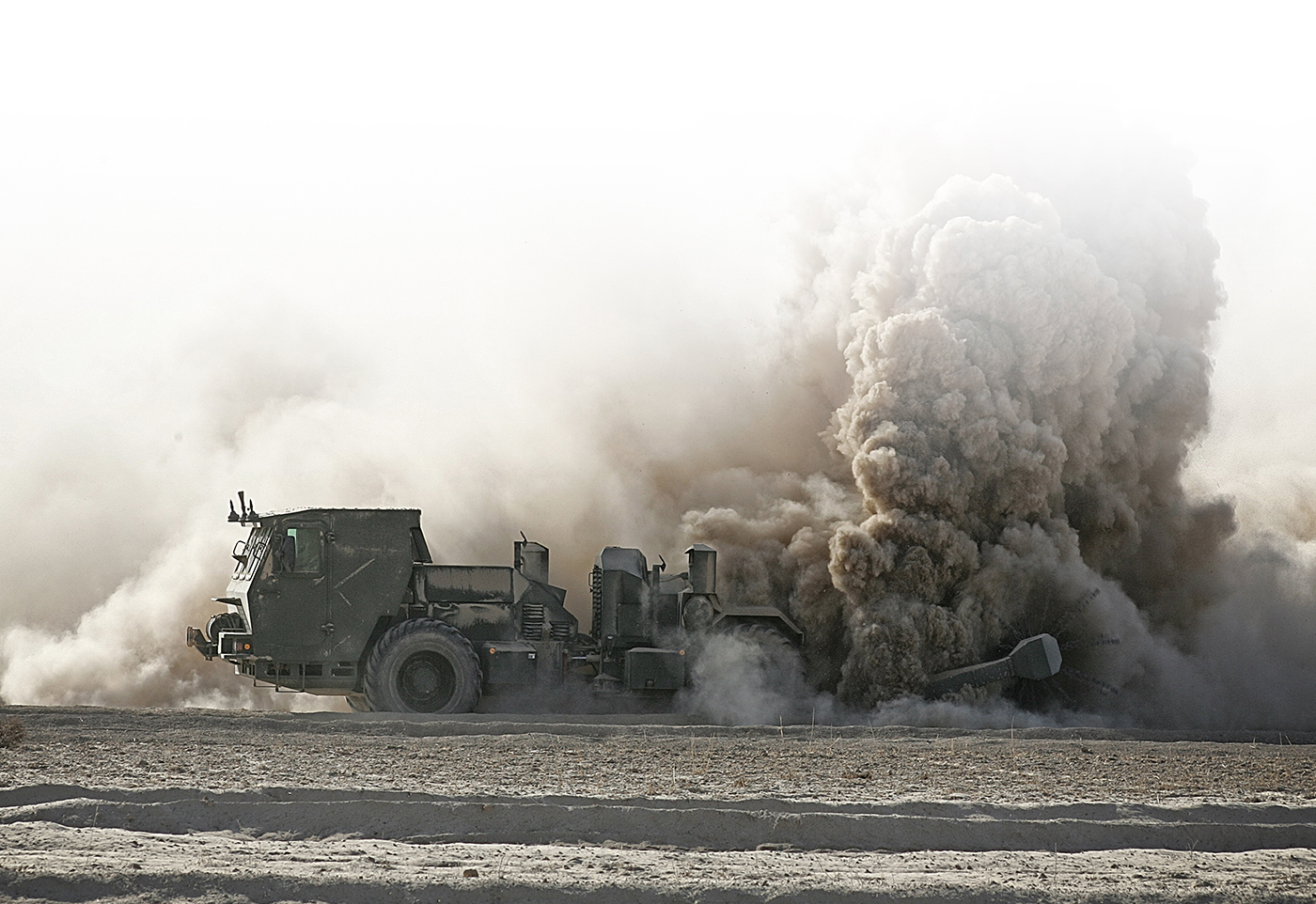Hydrema Mine-clearing vehicle in action desert